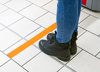 Marking tape for social distancing during the Covid-19 crisisA very famous French telephone company provider was looking for some marking tapes for social distancing in their shops during the Covid-19 crisis.We've delivered our reference 62400, which is a single-sided cloth tape, in orange colour and with a high visibility neon finish. This tape has a good adhesion on most surfaces and offers a clean removal without residue.